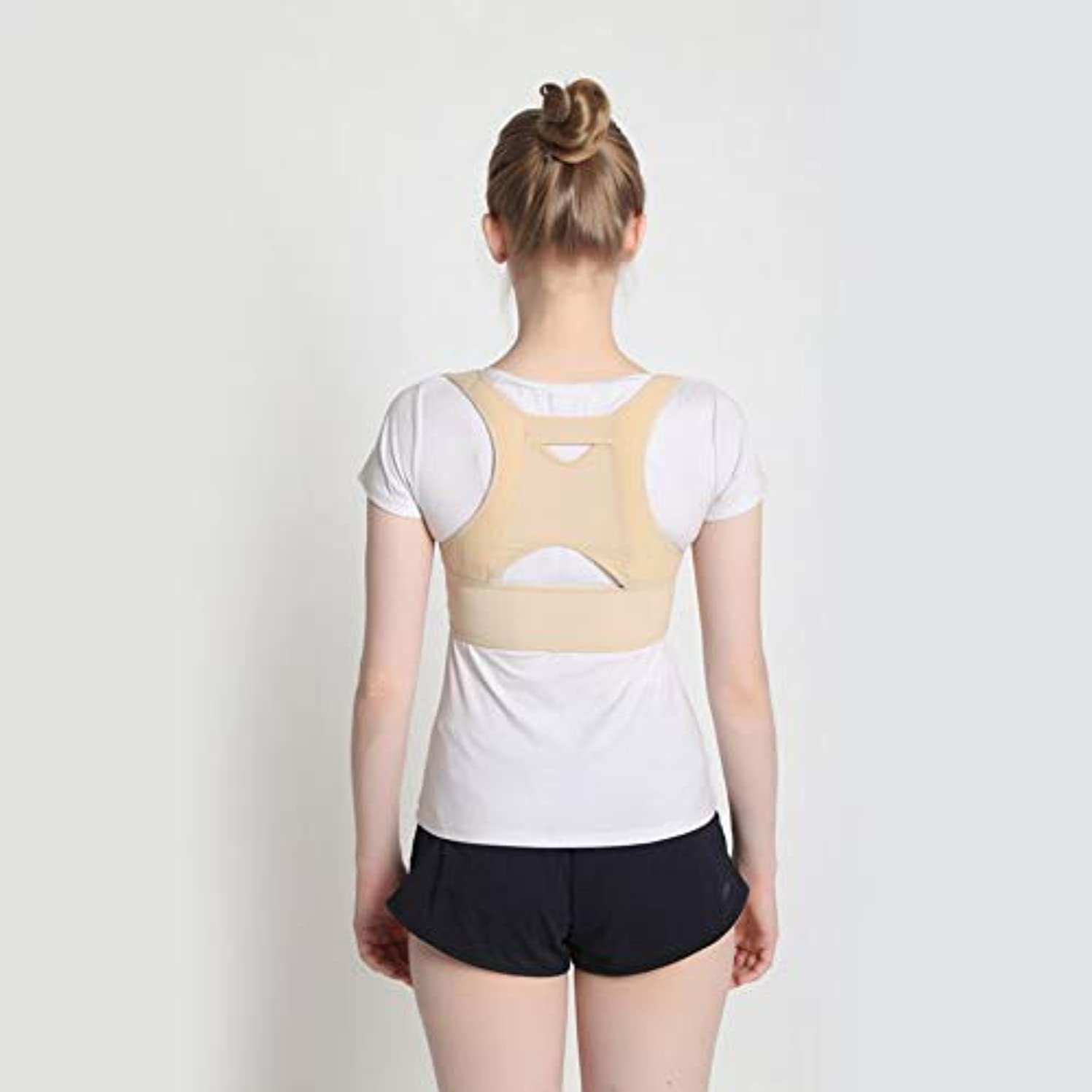出身地ハイキングに行くフォーク通気性のある女性の背中の姿勢矯正コルセット整形外科の肩の背骨の背骨の姿勢矯正腰椎サポート