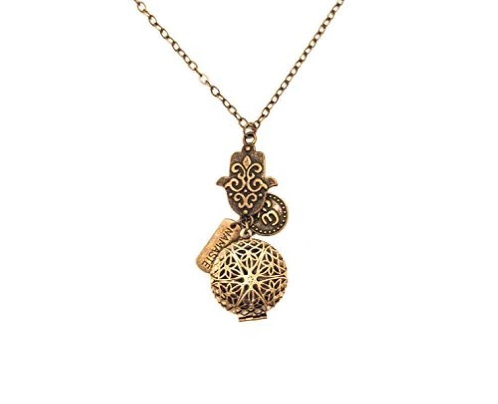外部山積みの横にHamsa Namaste and Om Bronze-tone Brass Tone Charms Aromatherapy Necklace Essential Oil Diffuser Locket Pendant...