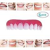 6枚の歯科用化粧板が歯の化粧化粧板の上部にぴったり合うサイズがすべての義歯の接着剤の歯に似ています偽の歯の笑顔