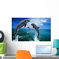 Wallmonkeys Dolphins Jumping in Ocean Wall Decal Peel and Stick Graphic WM99464 (24 in W x 14 in H) [並行輸入品]