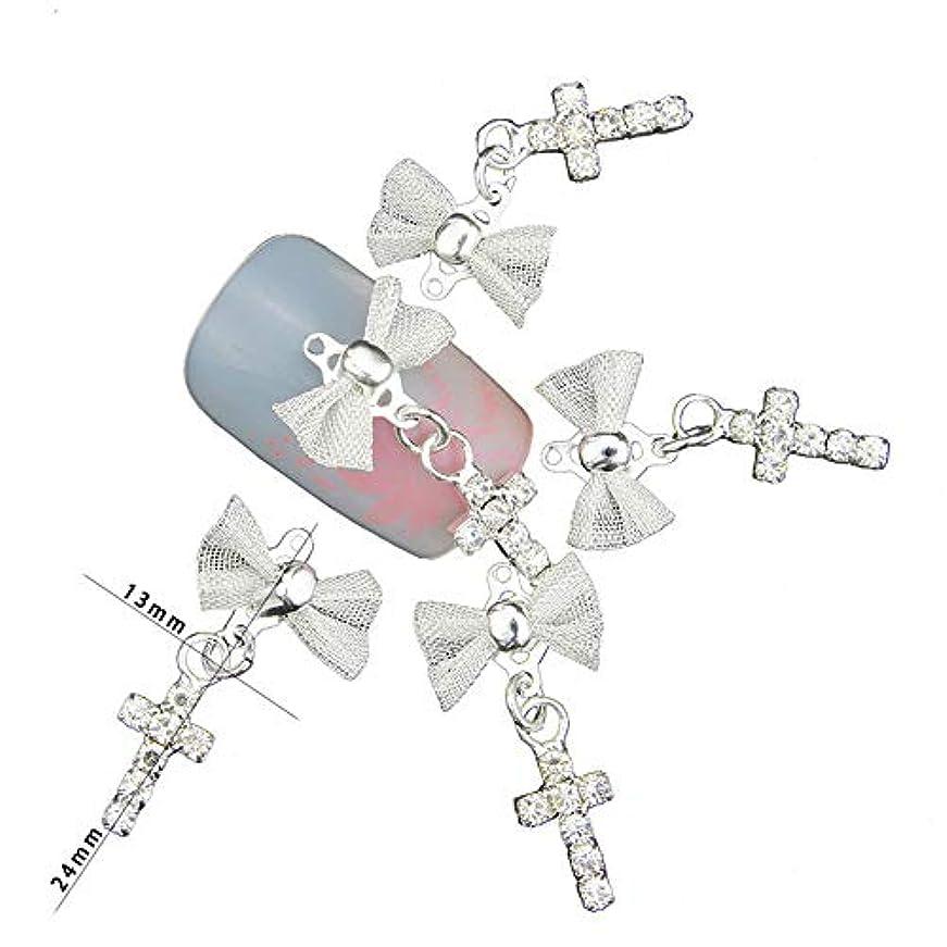 入り口刻む翻訳ネイルアートの装飾ジェルポーランドDIY合金チャームネイルズツールのための10個グリッター3D弓でクロスペンダントラインストーン
