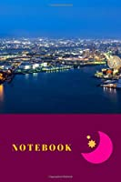 Notebook: This cool cover notebook/journal comes in 6 x 9 with a nice city-motif, wide ruled line paper