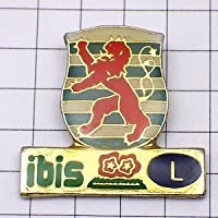 限定 レア ピンバッジ オレンジ色のライオン紋章イビスホテルL ピンズ フランス