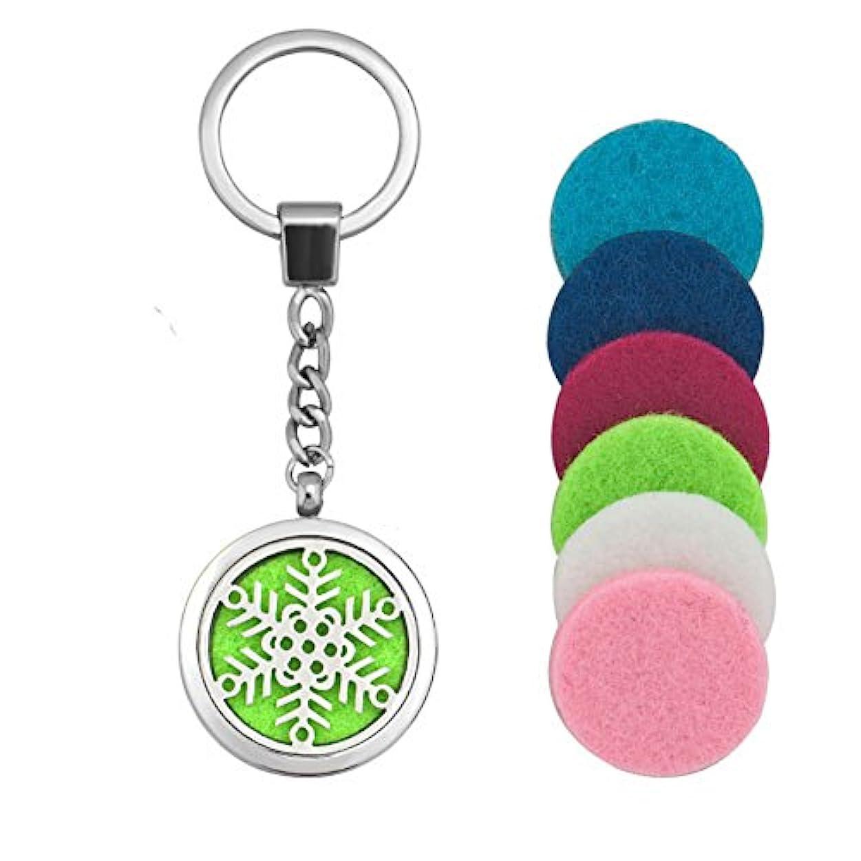 バーマド基本的な即席lilyjewelry Aromatherapy Essential Oil Diffuserクリスマススノーフレークロケットキーチェーン