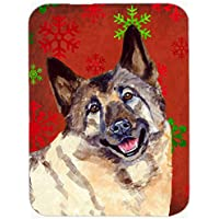 Carolines Treasures LH9353LCB Norwegian Elkhound Red And Green Snowflakes Christmas Glass Cutting Board - Large