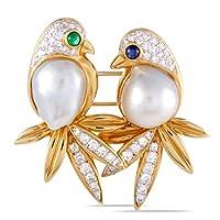 ラグジュアリー バザー 18K イエロー&ホワイトゴールド ダイヤモンド ペイブ、サファイア、エメラルドとパール 2羽の鳥ブローチ