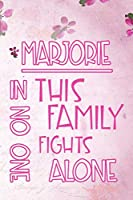 MARJORIE In This Family No One Fights Alone: Personalized Name Notebook/Journal Gift For Women Fighting Health Issues. Illness Survivor / Fighter Gift for the Warrior in your life | Writing Poetry, Diary, Gratitude, Daily or Dream Journal.