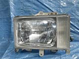 三菱ふそう 純正 キャンター 《 FB308B 》 左ヘッドライト P81700-15007812