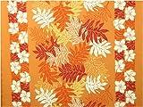 ハワイ直輸入の生地(ハワイアンファブリック)/オレンジ地にオレンジ系の濃淡のモンステラ、サイドにプルメリアが描かれているボーダー柄