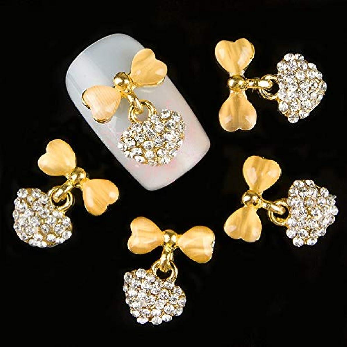 リラックスしたシャーロットブロンテ曇った10個入りの3D金の弓のきらめき宝石装飾ネイルアートのヒントデコレーションネイルスタッズラインストーン