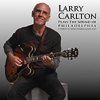 Plays the Sound of Philadelphia by Larry Carlton (2011-06-07)