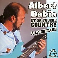Et Sa Touche Country a La Guitare