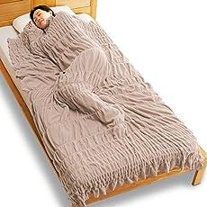 通販生活のヒートコットンケット 「羽毛布団でも寒い」とおっしゃる超寒がり屋さんへ。この発熱コットン肌掛けなら、「ひと晩中、ポカポカ」、保証します。/送料込み価格/カタログハウス